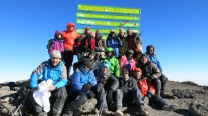 Kili team on the summit of Uhuru Peak