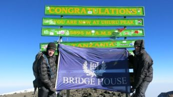 Josh with Bridgehouse School Flag